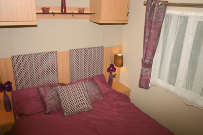 A double bed is standard in the main bedroom