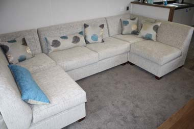 Sofa inside the Willerby 2014 3-bed Skyline holiday home