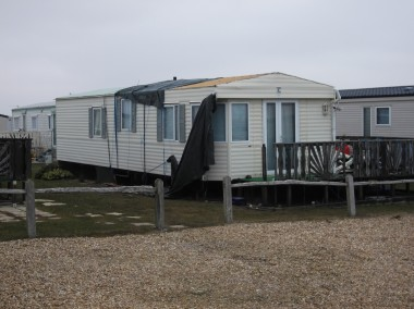 static caravan with roof damage