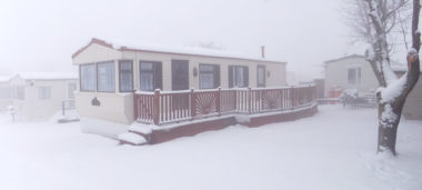 static caravan in the snow