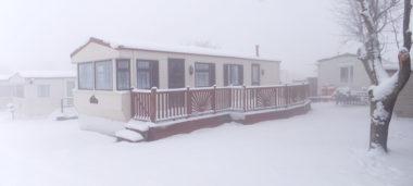 Static caravan in snow in winter