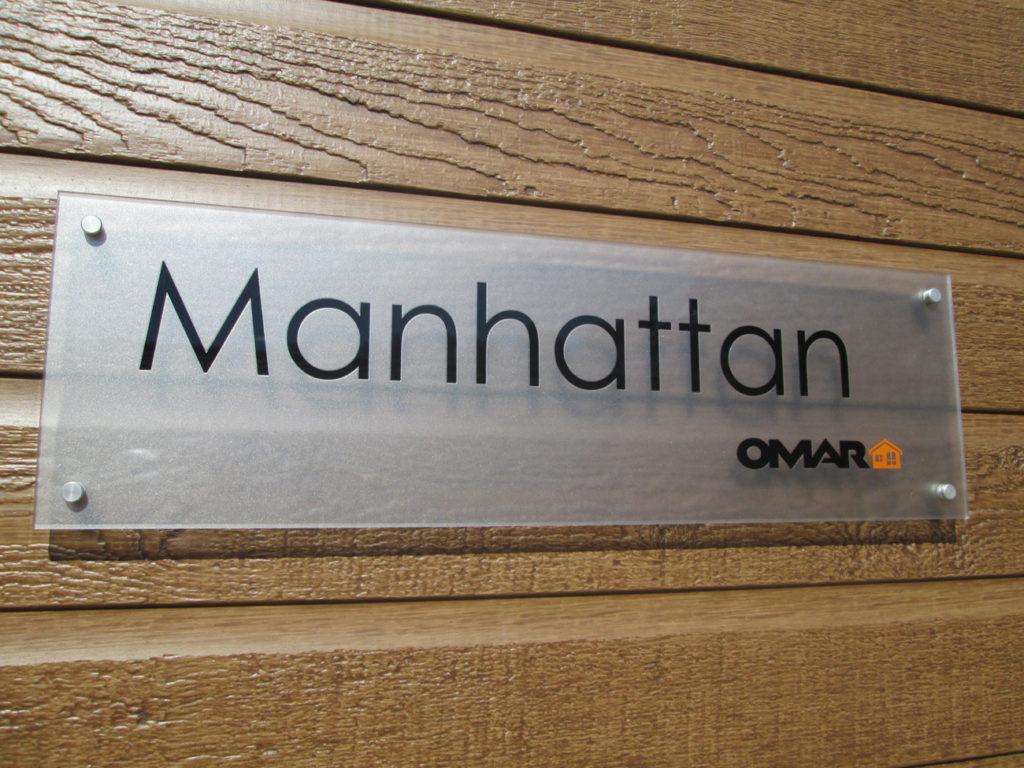 Omar Manhattan Sign